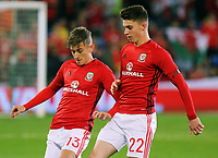 (L-R) David Brooks and Ben Woodburn of Wales warm up during the FIFA World Cup Qualifier Group D match between Wales and Republic of Ireland at The Cardiff City Stadium, Wales, UK. Monday 09 October 2017