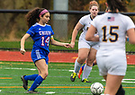 WOODBURY, CT-111120JS10 —Nonnewaug's Grace Koukopoulos (14) runs the ball through a pair of Wolcott Tech defenders during their game Wednesday at Nonnewaug High School. <br /> Jim Shannon Republican-American