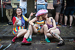 © Joel Goodman - 07973 332324 - all rights reserved . 25/08/2019. Manchester, UK. Two women share a kiss . Revellers in Manchester's Gay Village during the city's annual Gay Pride festival , which celebrates LGBTQ+ life and is the largest of its type in Europe . Photo credit : Joel Goodman