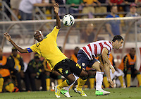 COLUMBUS, OHIO - SEPTEMBER 11, 2012:  Carlos Bocangra (3) of the USA MNT backs into Luton Shelton (21) of  Jamaica during a CONCACAF 2014 World Cup qualifying  match at Crew Stadium, in Columbus, Ohio on September 11. USA won 1-0.