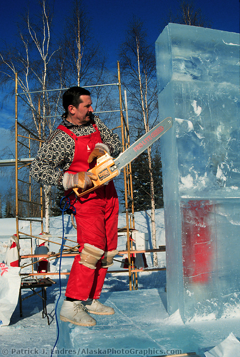 Ice sculptor shapes carving at the World Ice Art Championships held each march in Fairbanks, Alaska
