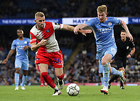 21st September 2021; Etihad Stadium,Manchester, England; EFL Cup Football Manchester City versus Wycombe Wanderers; Kevin De Bruyne of Manchester City takes on Jason McCarthy of Wycombe Wanderers
