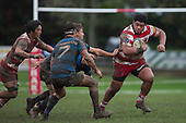 Antonio Lavemai looks to evade the Onewhero tacklers as he heads upfield. Counties Manukau Premier Club Rugby game between Karaka and Onewhero, played at Karaka on Saturday June 25th 2016. Karaka won the game 15 - 10 after leading 10 - 3 at halftime.<br />  Photo by Richard Sprnger.