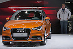 """December 30, 2011, Tokyo, Japan - A foreign visitor looks at the Audi """"A1 1.4 T"""" vehicle during the 42nd Tokyo Motor Show. The show opens to the general public from December 3-11. (Photo by Christopher Jue/AFLO)"""