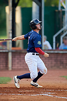 Elizabethton Twins catcher Andrew Cosgrove (5) follows through on a swing during a game against the Bristol Pirates on July 28, 2018 at Joe O'Brien Field in Elizabethton, Tennessee.  Elizabethton defeated Bristol 5-0.  (Mike Janes/Four Seam Images)