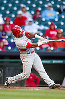 Houston Cougars third baseman Jonathan Davis #40 hits a grand slam home run against the Baylor Bears in the NCAA baseball game on March 2, 2013 at Minute Maid Park in Houston, Texas. Houston defeated Baylor 15-4. (Andrew Woolley/Four Seam Images).