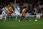 Motherwell 3 Dundee 1, 12/12/2015. Fir Park, Scottish Premiership. Home forward Scott McDonald fires his team into an early lead as Motherwell (in amber) play Dundee in a Scottish Premiership fixture at Fir Park. Formed in 1886, the  home side has played at Fir Park since 1895. Motherwell won the match by three goals to one, watched by a crowd of 3512 spectators. Photo by Colin McPherson.