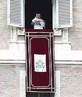 Papa Francesco recita l'Angelus domenicale affacciato su piazza San Pietro dalla finestra del suo studio. Citta' del Vaticano, 30 dicembre, 2018.<br /> Pope Francis recites the Sunday Angelus noon prayer from the window of his studio overlooking St. Peter's Square, at the Vatican, on December 30, 2018.<br /> UPDATE IMAGES PRESS/IsabellaBonotto<br /> <br /> STRICTLY ONLY FOR EDITORIAL USE