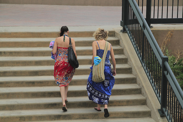 Two woman walking upstairs after swimming in Denver, Colorado. .  John offers private photo tours in Denver, Boulder and throughout Colorado. Year-round Colorado photo tours.