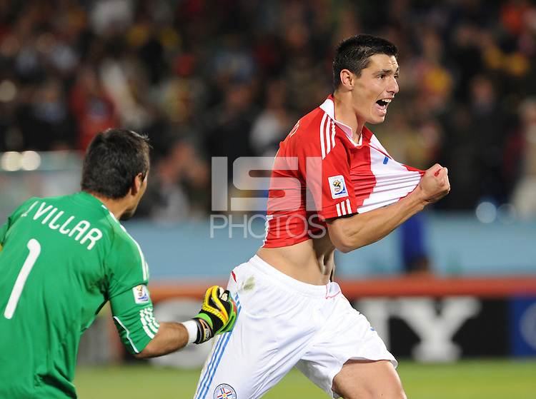Oscar Cardozo celebrates his penalty kick conversion, which earned Paraguay advancement into the quarterfinals. Japan and Paraguay played in the second round of the 2010 FIFA World Cup in Loftus Versfeld Stadium, in Pretoria, South Africa, June 29th. After regulation and extra time ended 0-0, Paraguay advanced to the quarterfinals, 5-3, in a penalty-kick shootout.