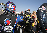 Apr. 7, 2013; Las Vegas, NV, USA: NHRA top fuel dragster driver Antron Brown (left) congratulates Tony Schumacher who celebrates after winning the Summitracing.com Nationals at the Strip at Las Vegas Motor Speedway. Mandatory Credit: Mark J. Rebilas-