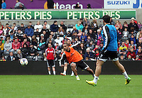 Wednesday, 23 April 2014<br /> Pictured: Wayne Routledge (C)<br /> Re: Swansea City FC are holding an open training session for their supporters at the Liberty Stadium, south Wales,