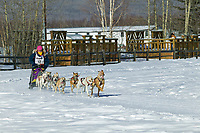 Musher Don Cousins passes Creamers Field on day three of the oldest continuously run sled dog race in the world, the 2003 Open North American Sled dog championships, Fairbanks, Alaska. The annual race consists of three daily races, the combined fastest time wins.