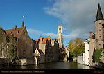 Canal Scene: Djiver at Rozenhoedkaai Red Hat Quay, Wollestraat Hotels, Belfort Bell Tower, Duc de Bourgogne and Huidevettershuis Tanner's Guild Tower, Bruges, Brugge, Belgium