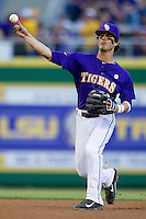 LSU Tigers second baseman Kramer Robertson #3 makes a throw to first base during the Southeastern Conference baseball game against the Georgia Bulldogs on March 22, 2014 at Alex Box Stadium in Baton Rouge, La. The Tigers defeated the Bulldogs 2-1. (Andrew Woolley/Four Seam Images)