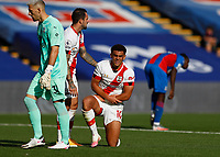 12th September 2020; Selhurst Park, London, England; English Premier League Football, Crystal Palace versus Southampton; Che Adams of Southampton hurts his arm with Danny Ings of Southampton looking on