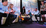 Wish granters watch as a gift is unveiled for Isaac Young, 3, and his parents Scott and Kristi at the Make-A-Wish Waffles & Wishes event at the Atlantis Casino Resort Spa in Reno, Nev., on Tuesday, March 26, 2013..Photo by Cathleen Allison