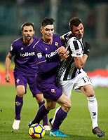 Calcio, Serie A: Fiorentina - Juventus, stadio Artemio Franchi Firenze 9 febbraio 2018.<br /> Juventus' Mario Mandzukic (r) in action with Fiorentina's Nikola Milenkovic  (c) and Milan Badelj (l) during the Italian Serie A football match between Fiorentina and Juventus at Florence's Artemio Franchi stadium, February 9, 2018.<br /> UPDATE IMAGES PRESS/Isabella Bonotto