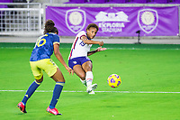 ORLANDO, FL - JANUARY 18: Crystal Dunn #19 of the USWNT kicks the ball during a game between Colombia and USWNT at Exploria Stadium on January 18, 2021 in Orlando, Florida.