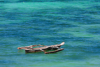 Jambiani, Zanzibar, Tanzania.  Outrigger Canoe (Ngalawa).  Indian Ocean.