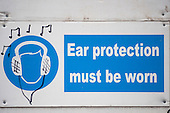 London, England. Ear protection sign with graffiti earphones and music notes.
