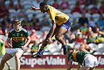 Chibby Okoye of Clare leaps over an opposition player during their Munster Minor football final against Kerry at Pairc Ui Chaoimh. Photograph by John Kelly.