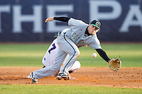 Connor Owings (6) of the Coastal Carolina Chanticleers chases down a wild throw as Dane McDermott (7) of the High Point Panthers steals second base at Willard Stadium on March 14, 2014 in High Point, North Carolina.  The Panthers defeated the Chanticleers 3-0.  (Brian Westerholt/Four Seam Images)