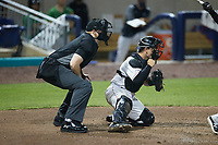 Kannapolis Cannon Ballers catcher Daniel Millwee (13) pumps his fist as home plate umpire Jacob McConnell looks on during the game against the Down East Wood Ducks at Atrium Health Ballpark on May 5, 2021 in Kannapolis, North Carolina. (Brian Westerholt/Four Seam Images)