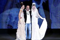 Roma 28/1/2004 <br /> Alta Moda Roma - Haute Couture - Fashion<br /> Dress collection of stylist Camillo Bona<br /> In this picture the Stylist Camillo Bona (in the center) with two his models, mother and daughter<br /> Foto Andrea Staccioli Insidefoto