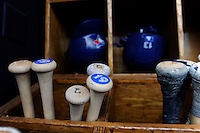 Toronto Blue Jays bats and batting helmets in the dugout before a Spring Training game against the New York Yankees at Steinbrenner Field on February 28, 2013 in Tampa, Florida.  Toronto defeated New York 1-0.  (Mike Janes/Four Seam Images)