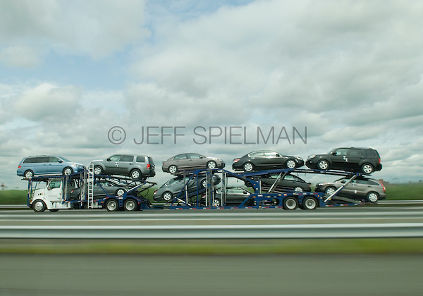 AVAILABLE FROM PLAINPICTURE FOR COMMERCIAL AND EDITORIAL LICENSING. Please go to www.plainpicture.com and search for image # p5690163.<br /> <br /> Car Transporter - Truck Transporting New Cars on Highway, New Jersey Turnpike, New Jersey, USA