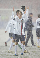 Eddie Lewis applauds the crowd for weathering the snow at Fritz-Walter Stadium, Kaiserslautern, Germany, Wednesday, March 1, 2006.
