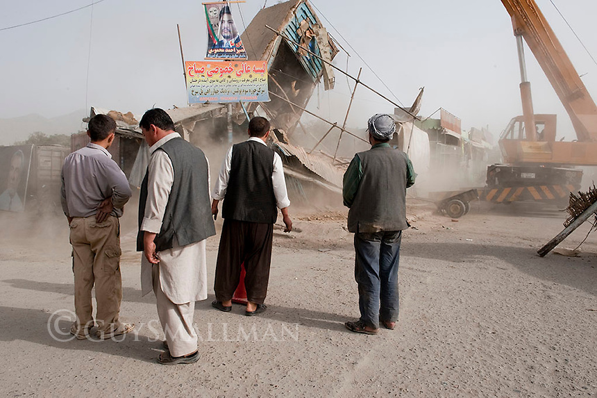 Municiple authorities in Kabul evict shop on the 'Red Bridge' by destroying them with heavy lifting gear. The shop keepers insisted that their businesses were legal and that they were being persecuted because of their ethnic Hazara status. Around 100 Police were in attendance.