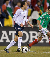 Landon Donovan carries the ball, Wed, Feb. 11, USA 2-0 over Mexico in a qualifying match for the 2010 World Cup, in Columbus, Ohio.