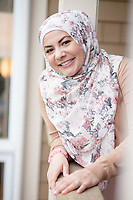 """SEATTLE, WA-APRIL 17, 2017: Amanda Saab, along with her husband Hussein Saab, co-hosted a """"dinner with your Muslim neighbor"""" at the home of Stefanie and Nason (cq) Fox in Seattle, WA on a return trip April 17th 2017. The couple now live in Detroit. The guests are <br /> Anjana Agarwal (black top), Patricia Rangel (black top with pattern), and Greg and Charissa (white top) Pomrehn.<br /> <br /> (Photo by Meryl Schenker/For The Washington Post)"""