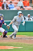 North Carolina Tar Heels third baseman Ashton McGee (5) swings at a pitch during a game against the Clemson Tigers at Doug Kingsmore Stadium on March 9, 2019 in Clemson, South Carolina. The Tigers defeated the Tar Heels 3-2 in game one of a double header. (Tony Farlow/Four Seam Images)