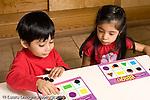Education Preschool 3-5 year olds board game boy and girl playing shapes bingo horizontal