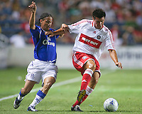 Chicago Fire defender Lider Marmol (23) wins a ball from Everton midfielder Steven Pienaar (20).  The Chicago Fire defeated English Premier League Team Everton FC 2-0 in a friendly match at Toyota Park in Bridgeview, IL, on July 30, 2008.