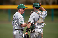 Dartmouth Big Green head coach Bob Whalen (2) talks with catcher Logan Adams (10) during a game against the USF Bulls on March 17, 2019 at USF Baseball Stadium in Tampa, Florida.  USF defeated Dartmouth 4-1.  (Mike Janes/Four Seam Images)