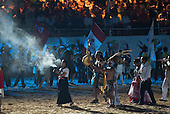 Canadian indigenous participants enter the arena during the opening ceremony at the first ever International Indigenous Games, in the city of Palmas, Tocantins State, Brazil. Photo © Sue Cunningham, pictures@scphotographic.com 23rd October 2015