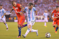 Action photo duringthe match Argentina vs Chile corresponding to the Final of America Cup Centenary 2016, at MetLife Stadium.<br /> <br /> Foto durante al partido Argentina vs Chile cprresponidente a la Final de la Copa America Centenario USA 2016 en el Estadio MetLife , en la foto:(i-d) Lionel Messi de Argentina y Arturo Vidal de Chile<br /> <br /> 26/06/2016/MEXSPORT/ISAAC ORTIZ