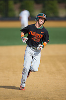 Carl Chester (45) of the Miami Hurricanes rounds the bases after hitting a home run against the Wake Forest Demon Deacons at Wake Forest Baseball Park on March 21, 2015 in Winston-Salem, North Carolina.  The Hurricanes defeated the Demon Deacons 12-7.  (Brian Westerholt/Four Seam Images)