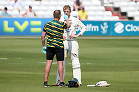 Lyndon James of Nottinghamshire is checked over by the physio after being struck on the helmet by a Paul Walter delivery during Essex CCC vs Nottinghamshire CCC, LV Insurance County Championship Group 1 Cricket at The Cloudfm County Ground on 3rd June 2021