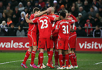 SWANSEA, WALES - MARCH 16: Jordan Henderson of Liverpool (R) celebrates his opening goal with team mates during the Premier League match between Swansea City and Liverpool at the Liberty Stadium on March 16, 2015 in Swansea, Wales