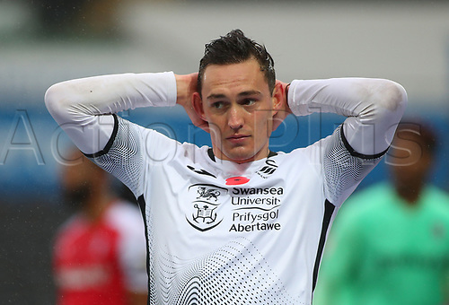 21st November 2020; Liberty Stadium, Swansea, Glamorgan, Wales; English Football League Championship Football, Swansea City versus Rotherham United; Connor Roberts of Swansea City reacts after team mate Jamal Lowe misses a clear chance