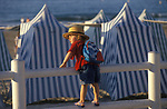 Brittany France 1990s A smartly dressed young boy on holiday traditional blue and white stripped beach canvas hits.