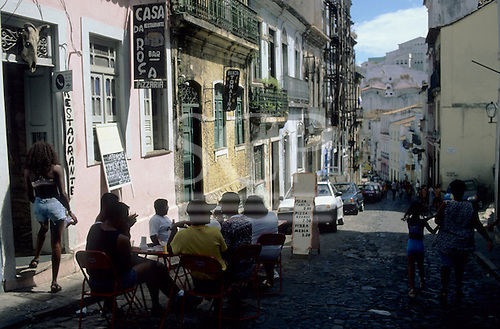 Salvador, Bahia State, Brazil. People sitting at a table outside a cafe bar; Pelhourino.