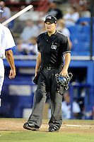 Umpire Ryan Additon explains a call to Dunedin Blue Jays manager Bobby Meacham (20 - not pictured) during a game against the Fort Myers Miracle on July 20, 2013 at Florida Auto Exchange Stadium in Dunedin, Florida.  Fort Myers defeated Dunedin 3-1.  (Mike Janes/Four Seam Images)