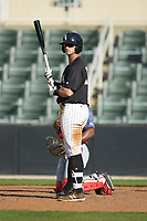 Tate Blackman (20) of the Kannapolis Intimidators looks to his third base coach for the signs during the game against the Hagerstown Suns at Kannapolis Intimidators Stadium on May 6, 2018 in Kannapolis, North Carolina. The Intimidators defeated the Suns 4-3. (Brian Westerholt/Four Seam Images)