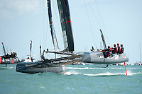 25 July 2015: Land Rover BAR attacks the windward mark during the America's Cup first round racing off Portsmouth, England (Photo by Rob Munro)